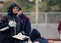 The Augsburg men's soccer coach talks to the team, 1998.