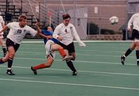 Adam Miller tackles an opponent hard, 1998.