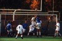 The Augsburg men's soccer team defend a corner, 1999.
