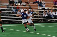 An Augsburg men's soccer player tries to get the ball, 2001.
