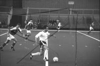 An Augsburg men's soccer player run with ball, 1993.