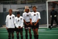 Four Auggie men's soccer players in a Wall, 1998.