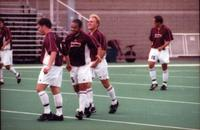 Hugo Quintiliano and his teammates get together in the midfield, 2000.