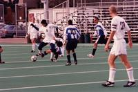 Jonas Giving pushes off a defender, 1997.