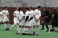 Four Augsburg men's soccer players defend a free kick against Gustavus Adolphus, 2002.