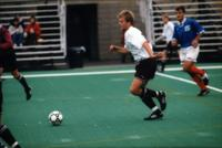 Auggie men's soccer player dribbles an opponent, 1998.