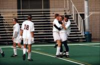 Five Augsburg men 's soccer players celebrate, 1997.