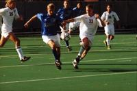 An Augsburg men's soccer player fight for the ball, 1999.