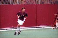 An Augsburg men's soccer player runs forward, 2000.