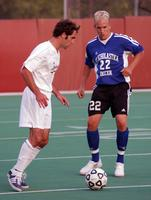 An Augsburg men's soccer player holds the ball in a game against St. Scholastica, 2003.