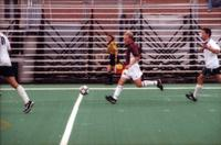 An Augsburg soccer player runs with the ball, 2000.