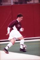 An Augsburg men's soccer player attacking the goal, 2000.