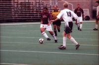 Hugo Quintiliano takes on a defender, 2000.
