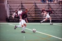An Augsburg men's soccer player dribble, 2000.