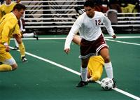 One Augsburg Men's soccer player takes the ball, circa 2000.