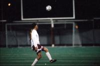 An Augsburg men's soccer player tries to control the ball, 1994.