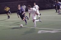 An Augsburg men's soccer player attacks the goal in a game against St. Thomas, 2003.