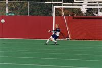 An Augsburg Men's soccer goalkeeper punts the ball, 2001.