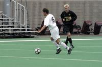 Matt Lachner dribbles through the middle against Gustavus Adolphus, 2002.