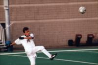 Daniel Parker kicks the ball, 1997 .
