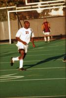 Emmanuel Kalu runs after the ball, 1999.
