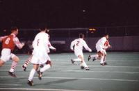 Eric Roy dribbles forward with the ball, 1996.