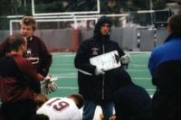 Auggies men's soccer coach addresses the team, 1995.