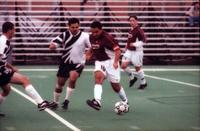 Carlos Martinez passes the ball, 2000.