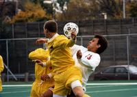 Two Augsburg men's soccer players playing a game at Edor Nelson Field, circa 2000.