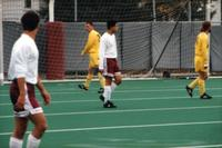 Two Augsburg men's soccer players stand and wait for the ball, 1995.
