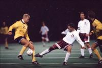 Jeremy Stickney fights to get the ball back, 1995.
