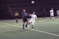 Jason Clark runs for the ball in a game against St. Thomas, 2003.