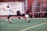 An Augsburg men's soccer player takes a shot, 2000.