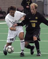 Matt Lachner tackles a opponent in a game against Gustavus Adolphus, 2002.