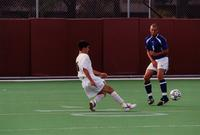 An Augsburg men's soccer player kicks a free kick, 2001.