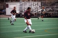 An Augsburg player passes the ball, 2000.