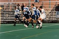 Auggies soccer player turns with the ball, 1997.