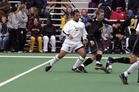 Hugo Quitiliano gets behind a Gustavus Adolphus player with the ball, 2002.