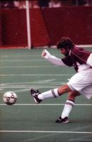An Augsburg men's soccer player shoots the ball, 2000.