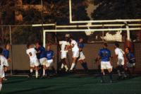 The Augsburg men' soccer team attacks a corner, 1999.
