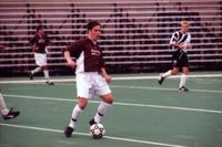 An Augsburg men's soccer player turns around with ball, 2000.