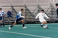 Eric Roy turns with the ball, 1997.