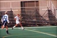 Auggie men's soccer Player dribbles forward, 1998.