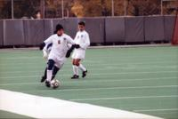Eli Schmitz runs forward with the ball, 1997.
