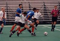 Eric Roy tries to get the ball from a defender, 1998.