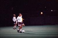 An Augsburg men's soccer player holds the ball in the midfields, 1994.