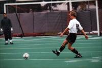 Auggie men's soccer Number 10 passes the ball, 1998.