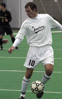 Mike Elcano holds the ball playing against Gustavus Adolphus, 2002.