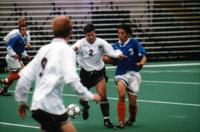 Eric Roy pushes a player off the ball, 1998.