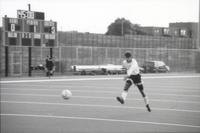 An Augsburg men's soccer player takes a shot, 1993.